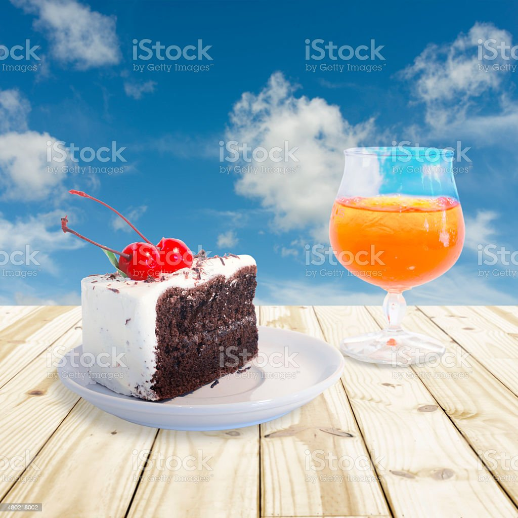 Cherry chocolate cake and Orange juice royalty-free stock photo