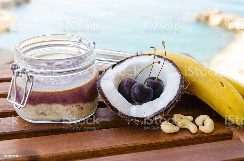 Cherry coconut banana overnight oats stock photo