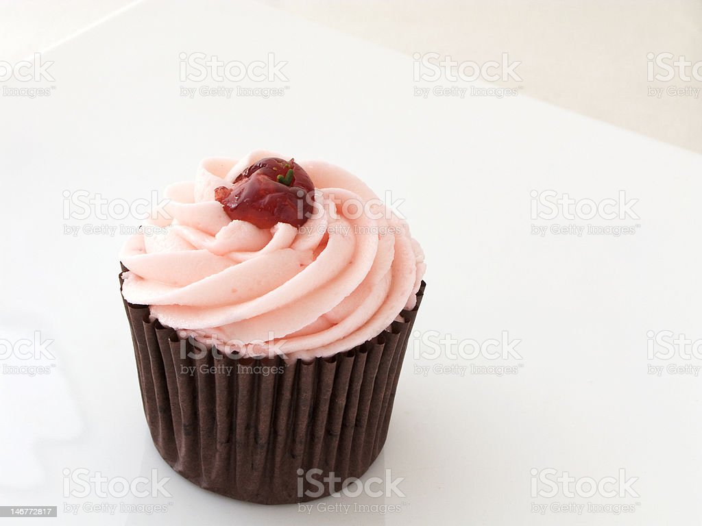 Cherry cupcake on a white background royalty-free stock photo