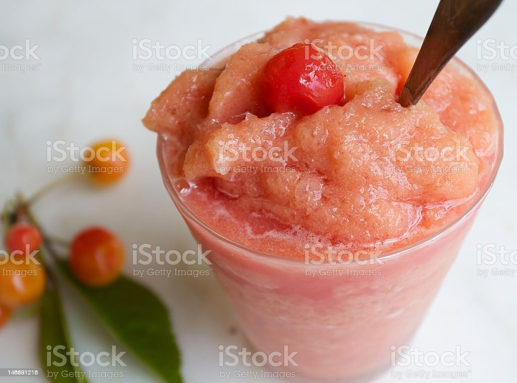 Cherry Flavored Ice in a Glass stock photo
