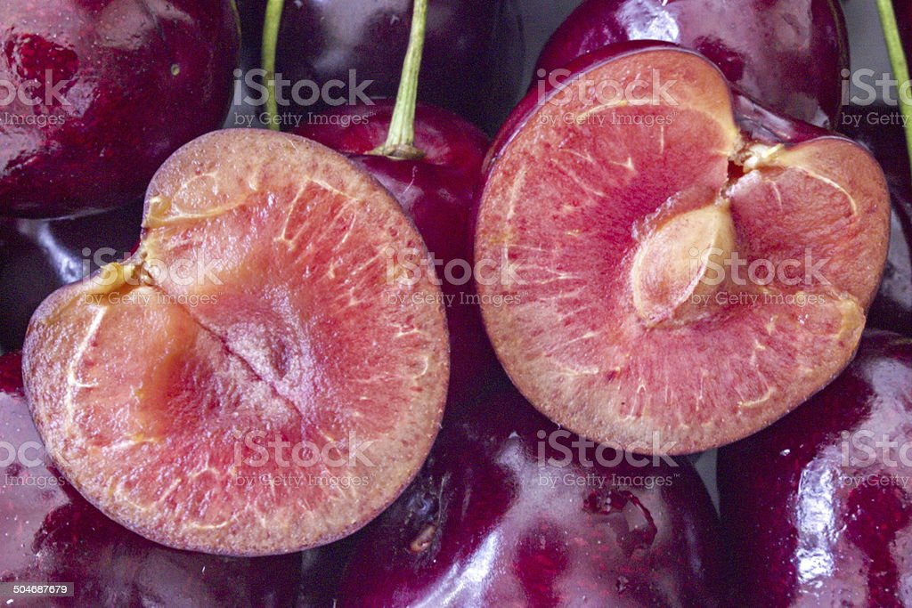 Cherry halves on a bunch of other cherries stock photo