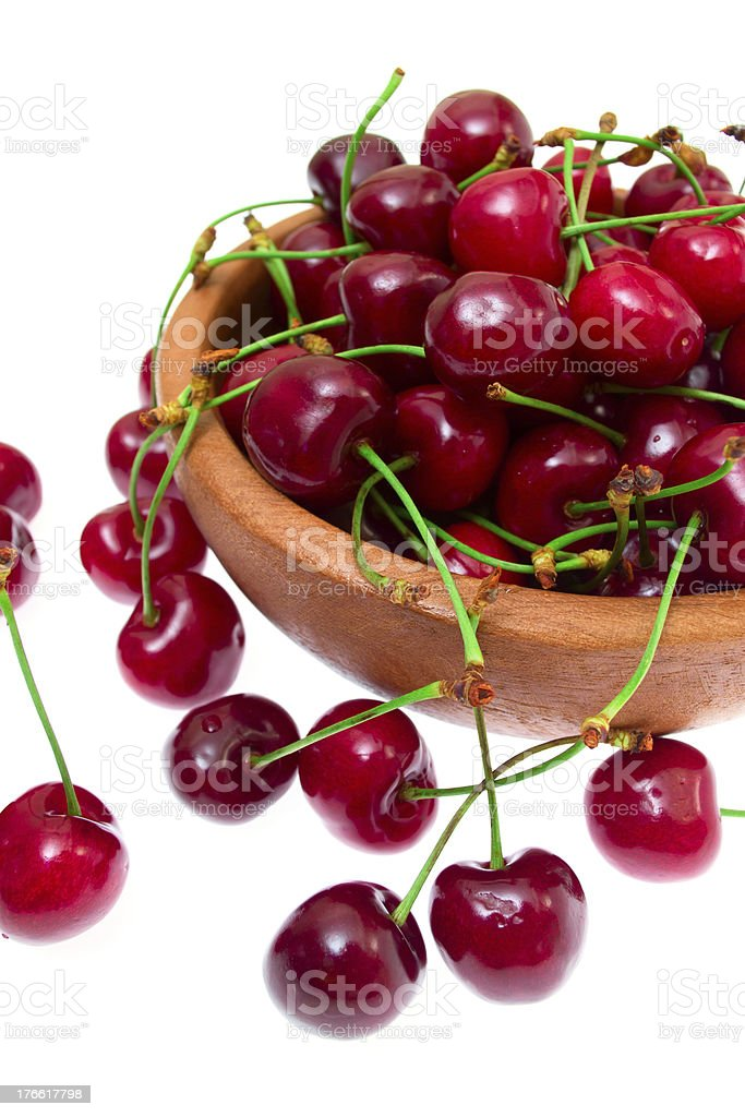 Cherry in wooden bowl isolated on white background royalty-free stock photo