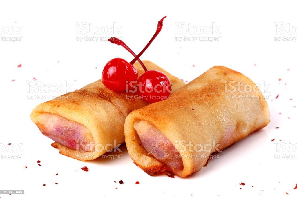 Cherry jam filled pancakes stock photo