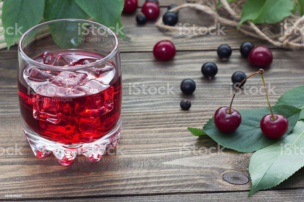 cherry juice with berries stock photo