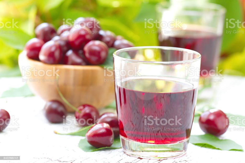 Cherry juice with fresh berries stock photo