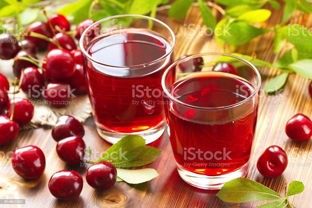 Cherry juice with fresh berries stock photo