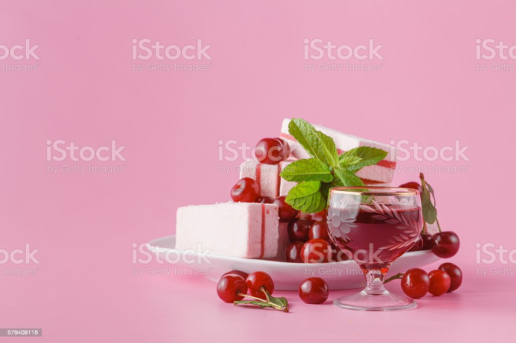 Cherry liqueur on pink stock photo
