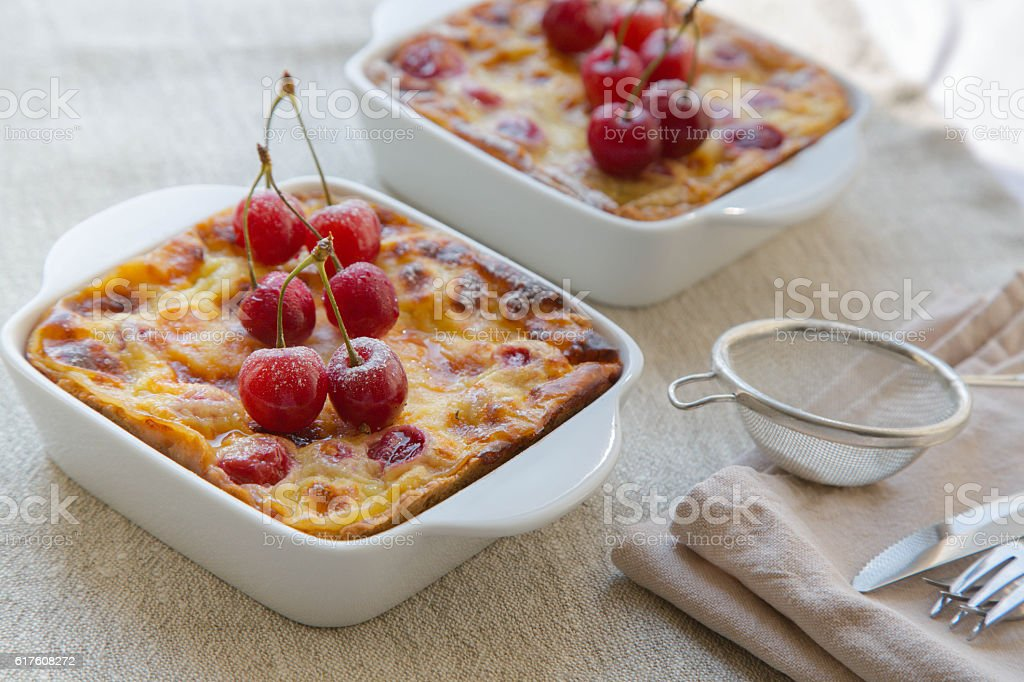 Cherry mini pies in the ceramic baking moulds stock photo