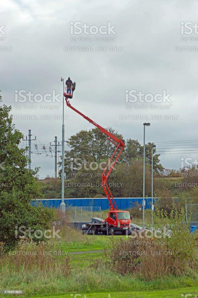Cherry picker checking cctv stock photo