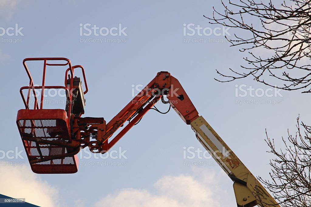 Cherry picker parked up in a depot stock photo
