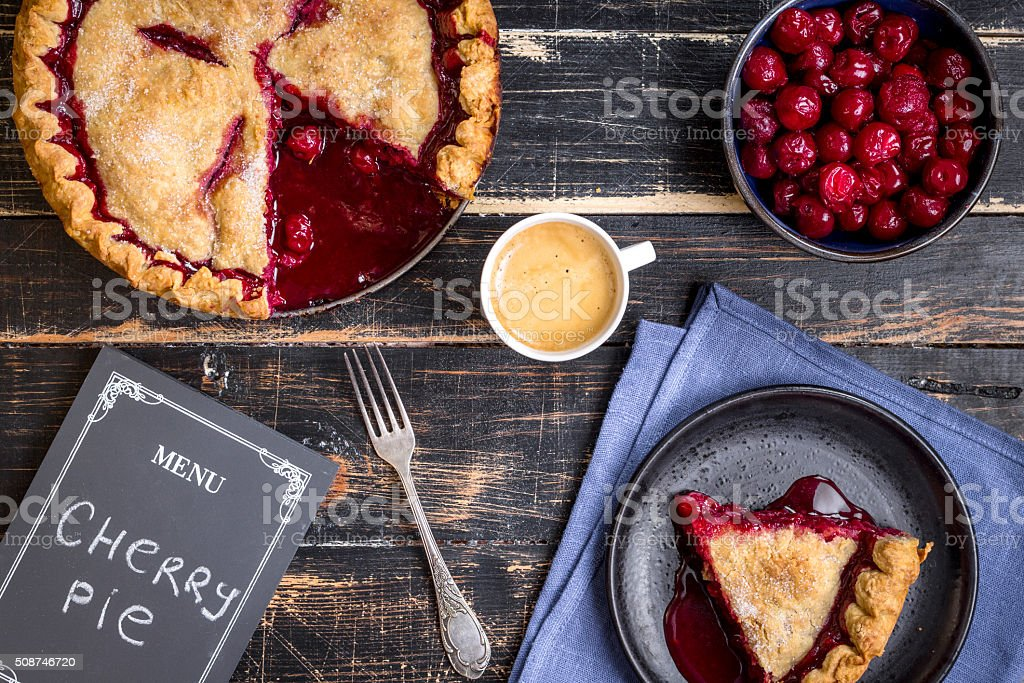 Cherry pie, cup of coffee and menu chalkboard stock photo