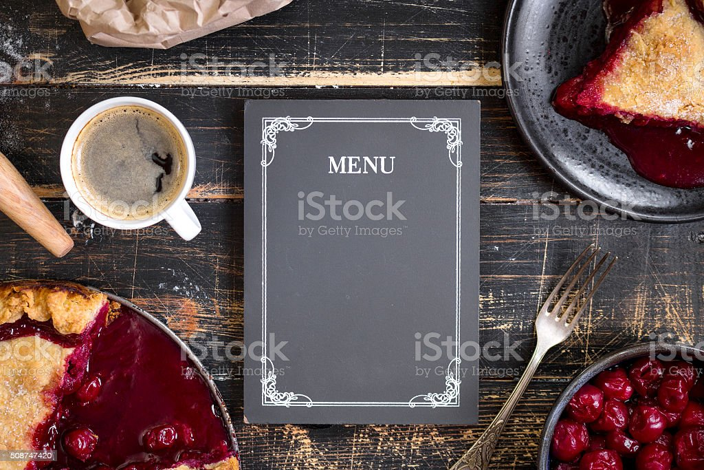 Cherry pie, flour, rolling pin and menu chalkboard background stock photo