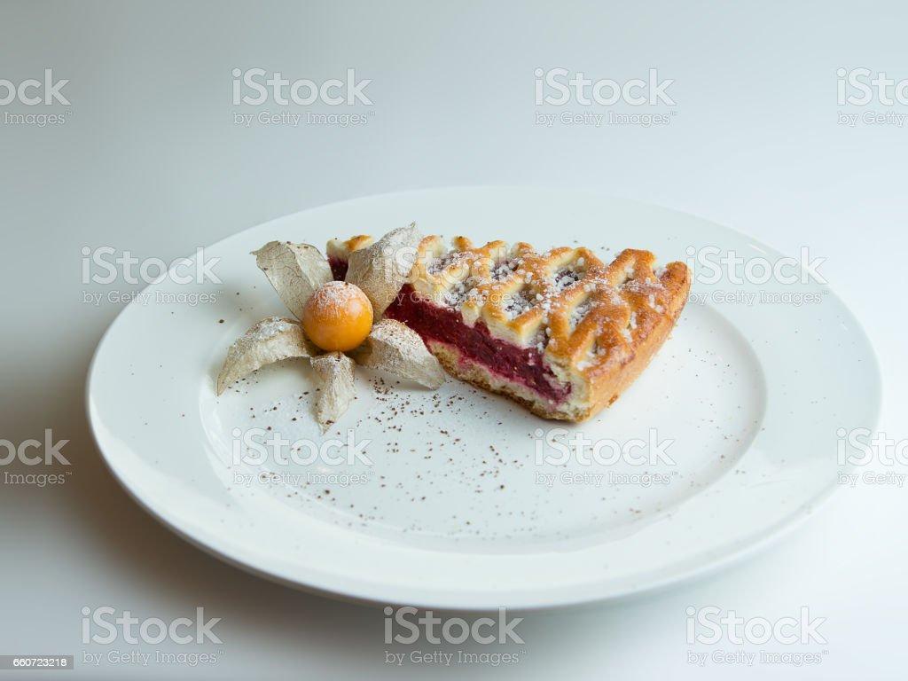 cherry pie on a white plate stock photo