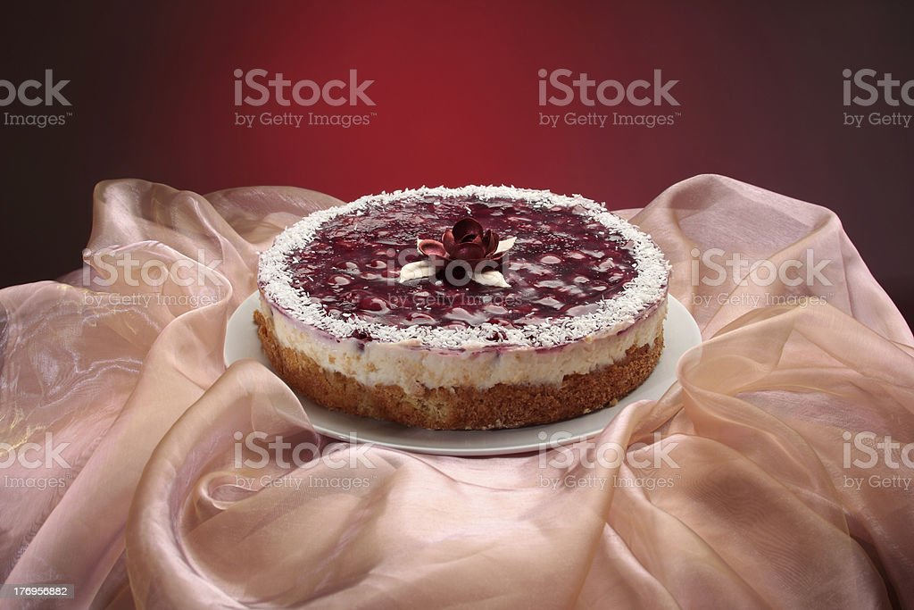 Cherry pie with rose on elegant pink stock photo