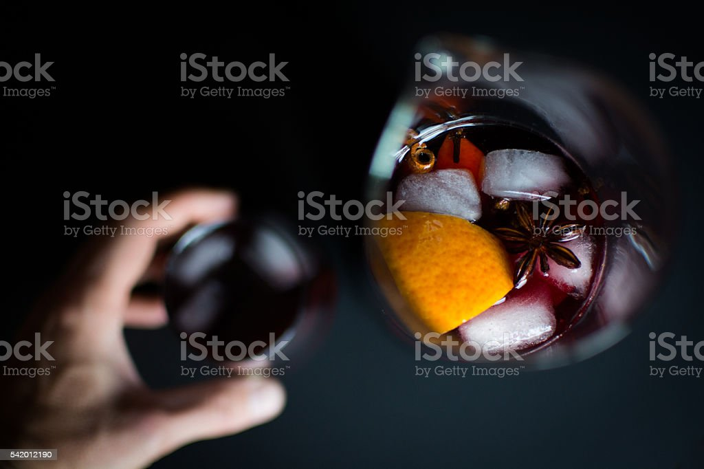cherry Sangria In Glassware on black from above stock photo
