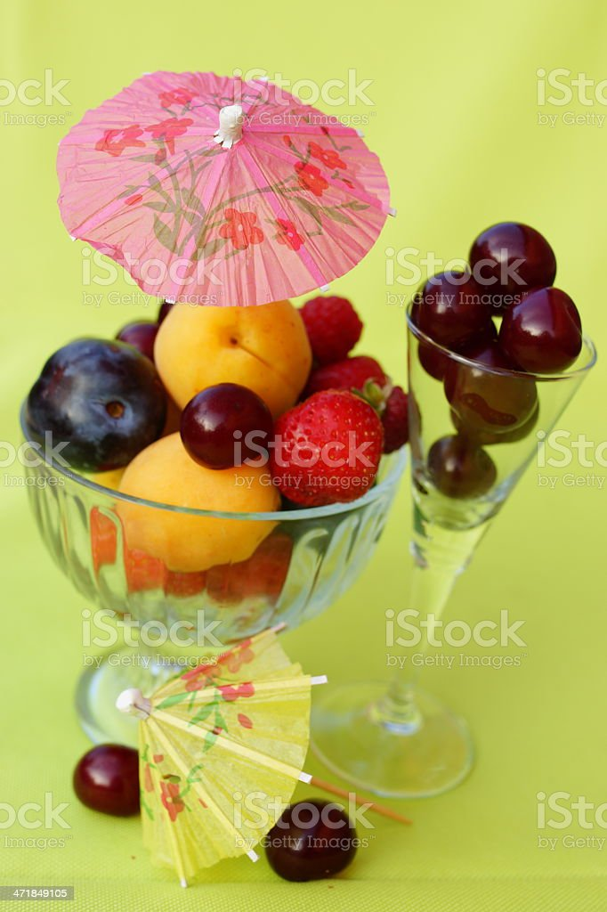 Cherry, strawberry, plum, apricot  together in a glass. royalty-free stock photo