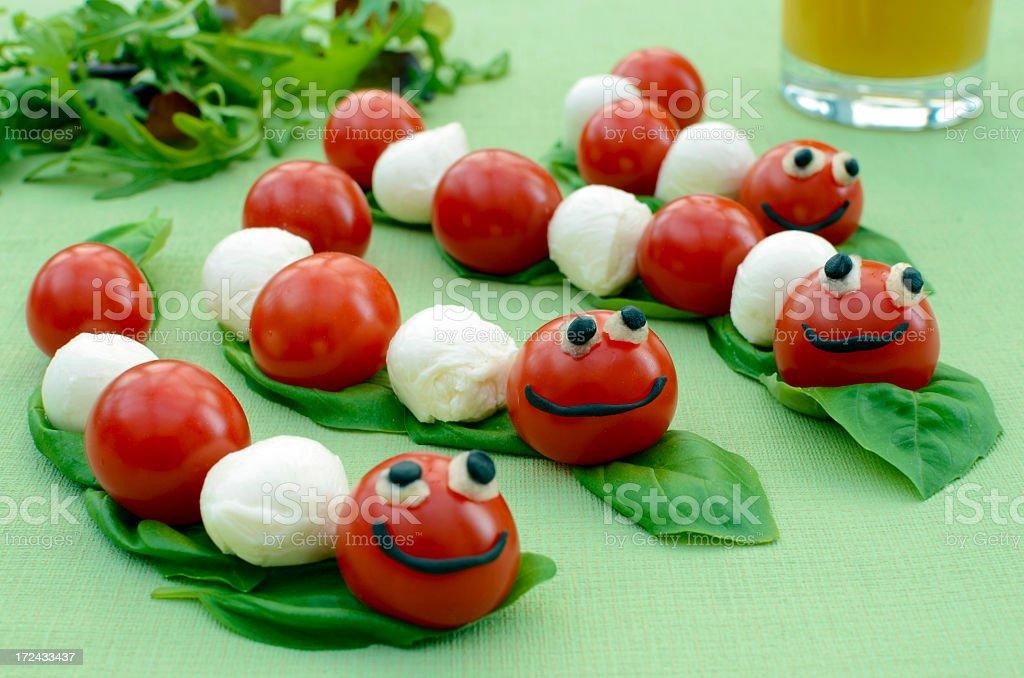 Cherry tomato and mozzarella caterpillars royalty-free stock photo