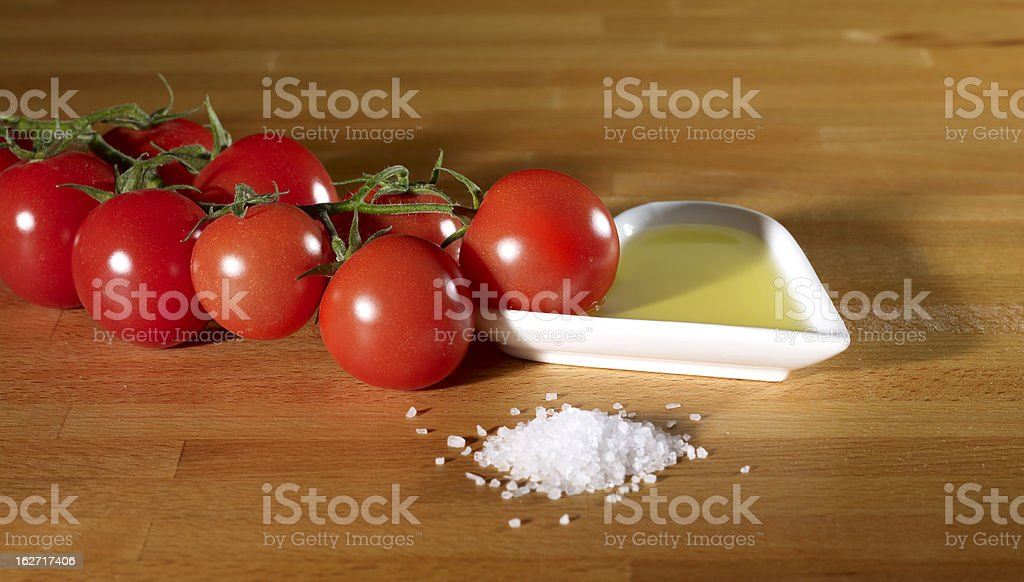 Cherry tomato and Olive oil (salt) stock photo