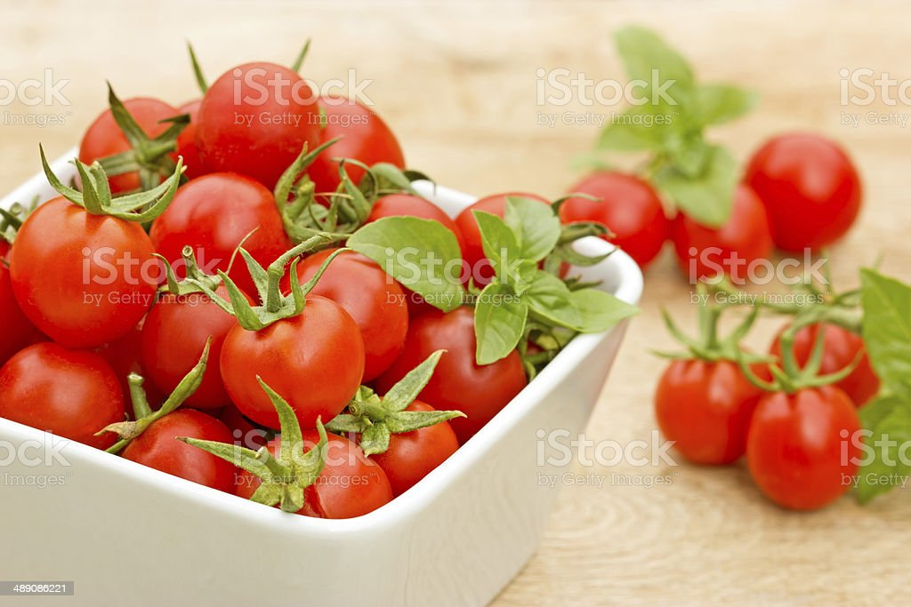 Cherry tomato in a bowl on the table royalty-free stock photo