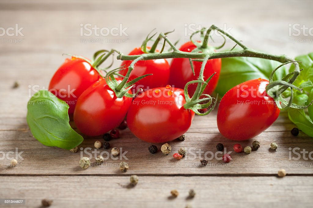 Cherry tomato on old wooden table stock photo