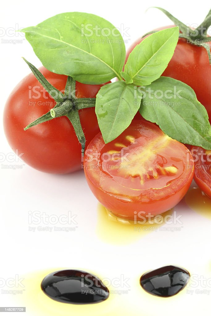 Cherry tomatoes and basil royalty-free stock photo