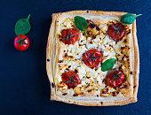 Cherry tomatoes and feta cheese tart, top view