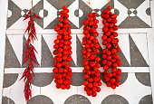 Cherry tomatoes are hanging on decorated wall, Chios island, Gre