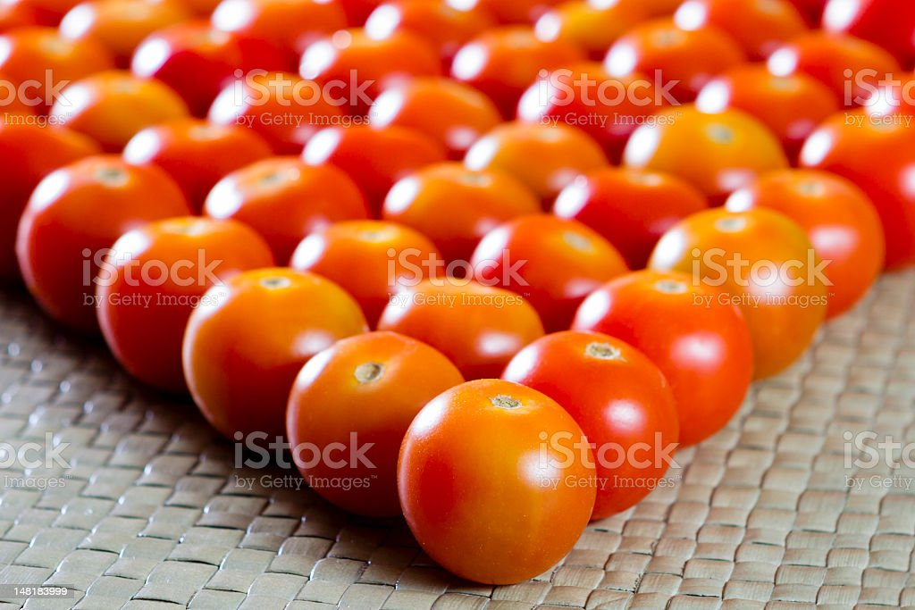 Cherry Tomatoes formed into a wedge. stock photo