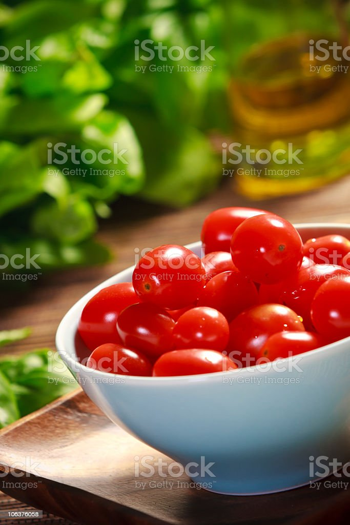 Cherry tomatoes in a blue bowl royalty-free stock photo