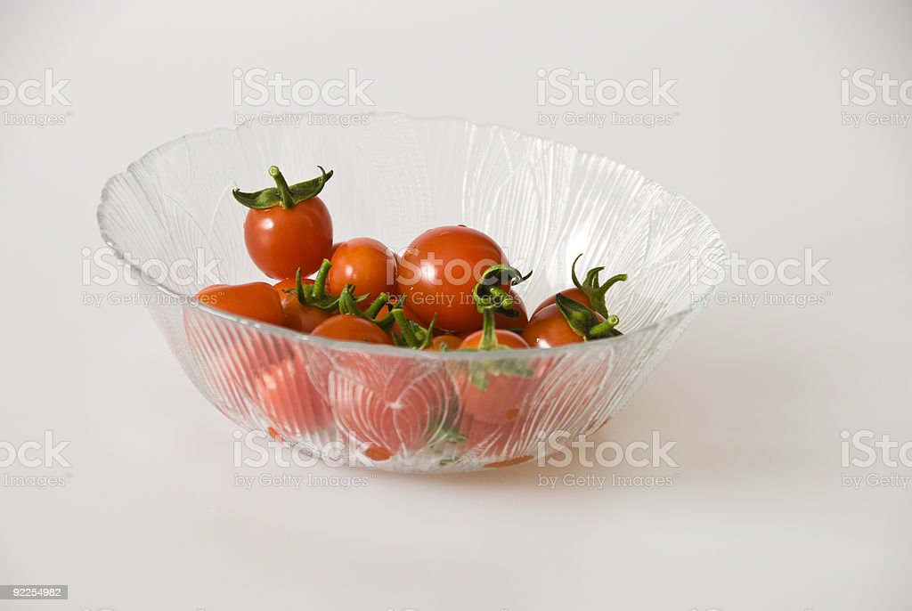 Cherry Tomatoes in a Glass Bowl stock photo
