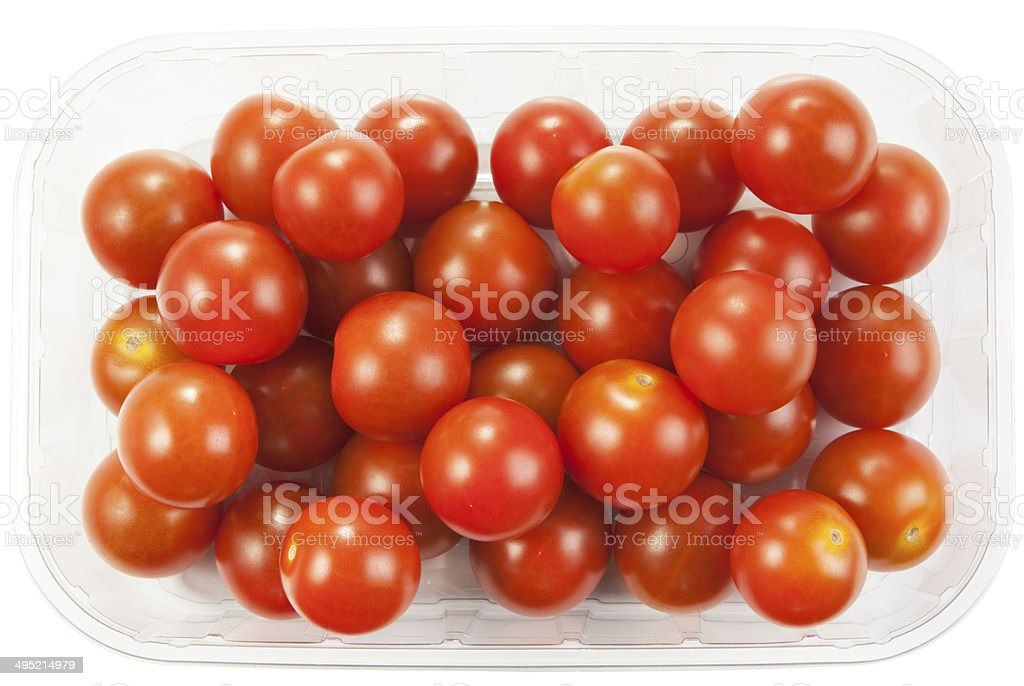 Cherry tomatoes in a plastic container on white background stock photo