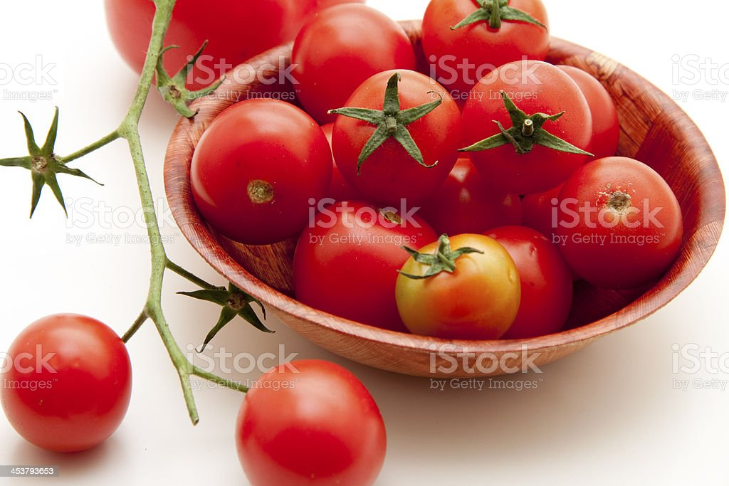 Cherry tomatoes in bowl stock photo