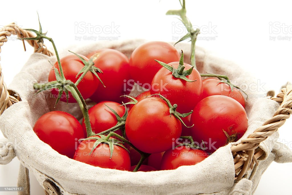 Cherry tomatoes in the basket stock photo