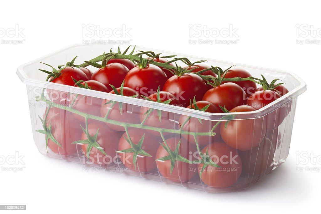 Cherry tomatoes on a branch in retail packaging royalty-free stock photo