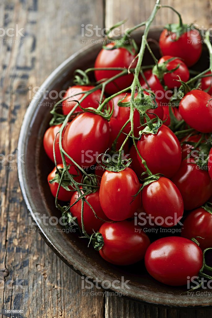 Cherry tomatoes on a ceramic plate stock photo
