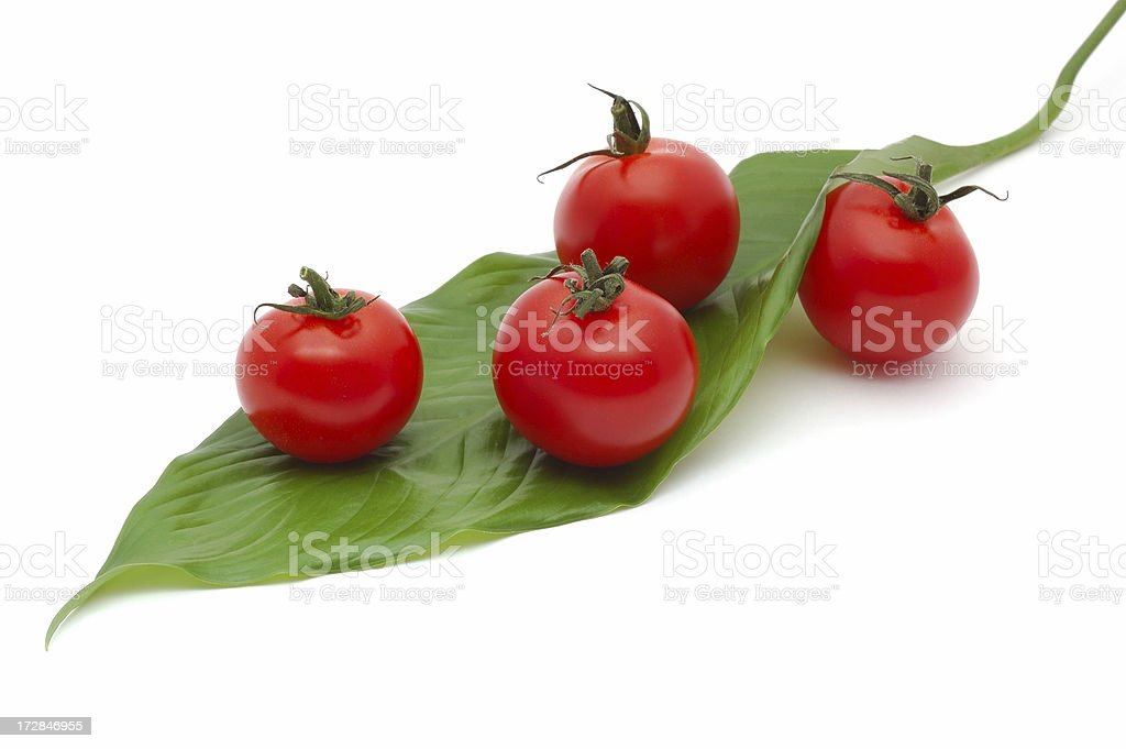 Cherry tomatoes on a green leaf royalty-free stock photo