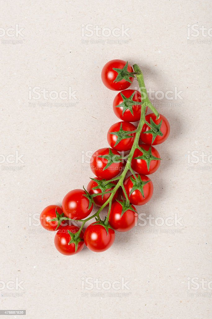 Cherry tomatoes on beige recycled paper stock photo