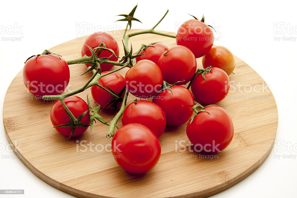 Cherry tomatoes on edge board stock photo