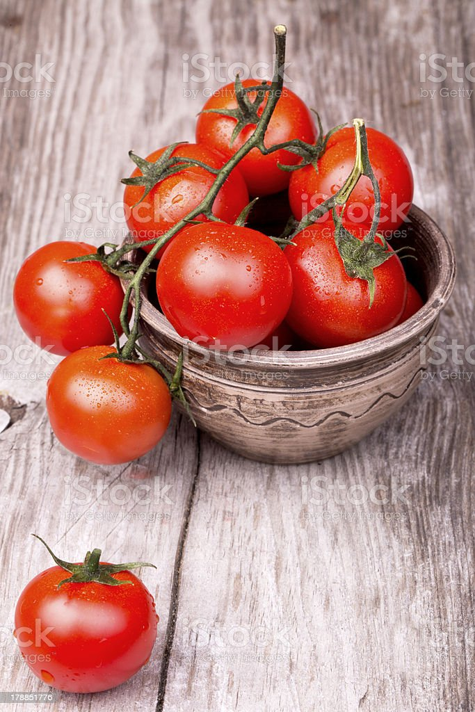 Cherry tomatoes on wooden table stock photo