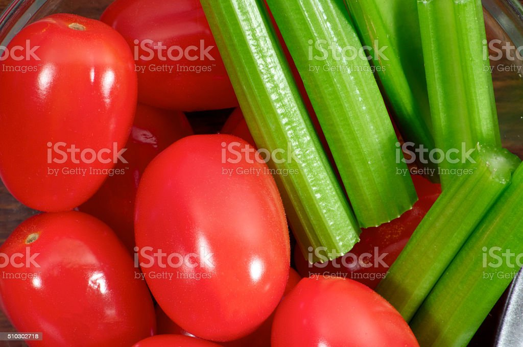 Cherry tomatoes with celery close up stock photo