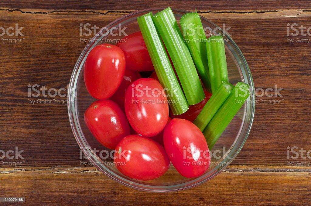 Cherry tomatoes with celery stock photo