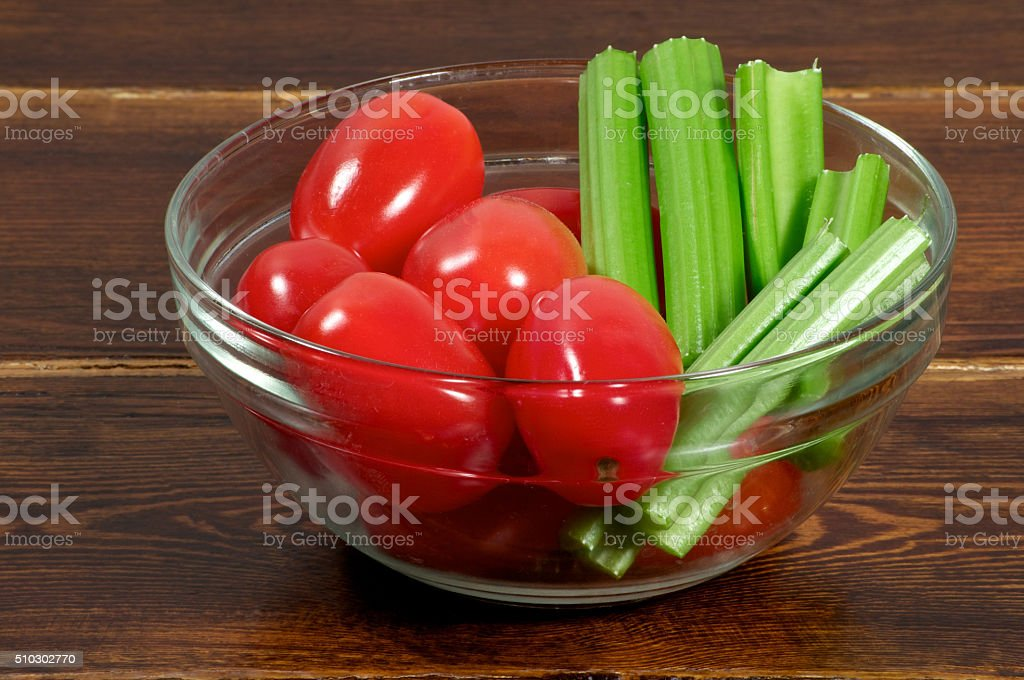 Cherry tomatoes with celery side stock photo
