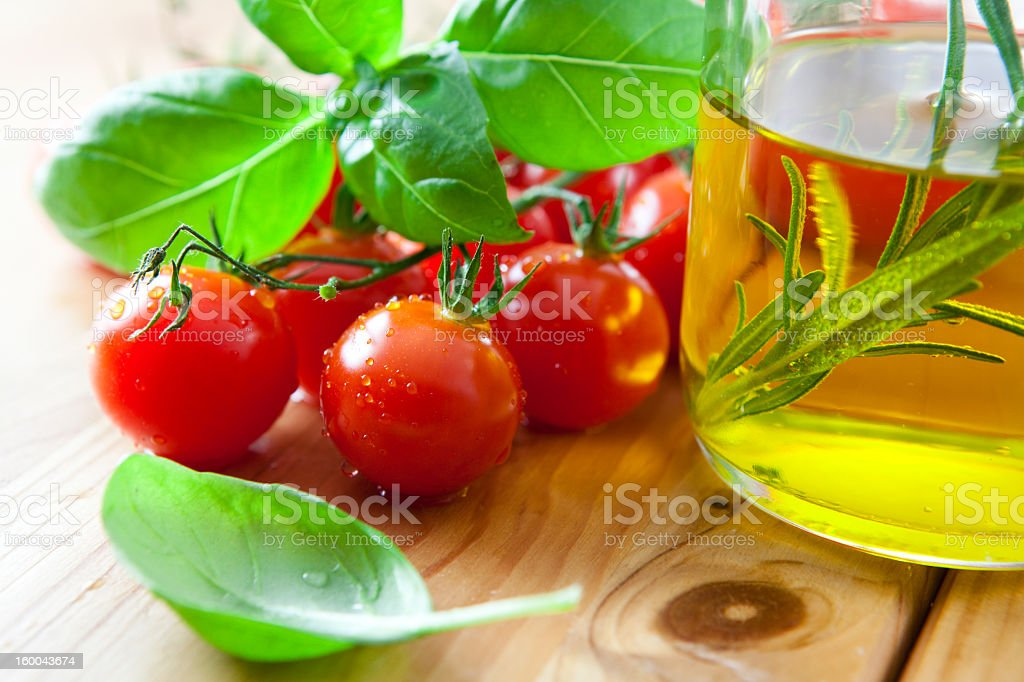 Cherry tomatoes with fresh basil and olive oil stock photo