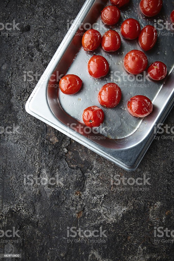 Cherry tomatoes with olive oil and maldon salt stock photo