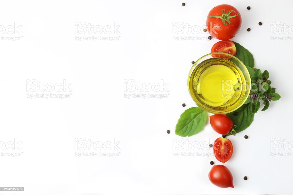 Cherry Tomatoes with Olive Oil, Basil and Black Peppercorn, stock photo