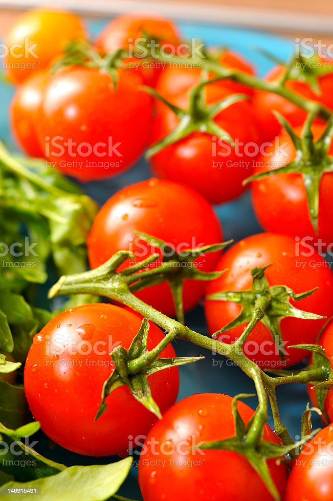 cherry tomatoes with ruccola royalty-free stock photo