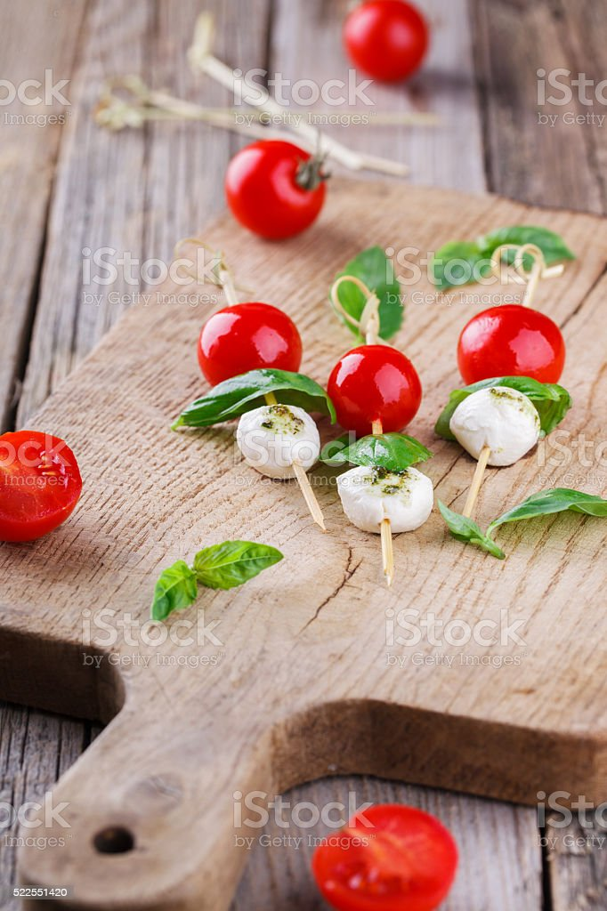 Cherry tomatoes,mozzarella and Basil on skewers stock photo