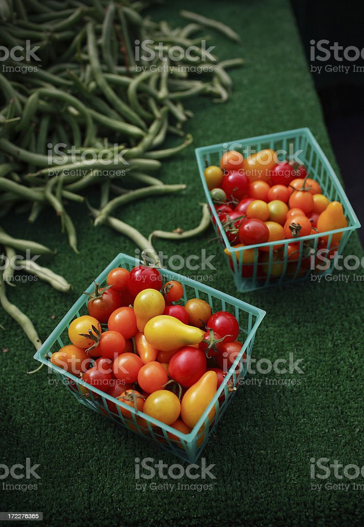 cherry tomatos and green beans stock photo