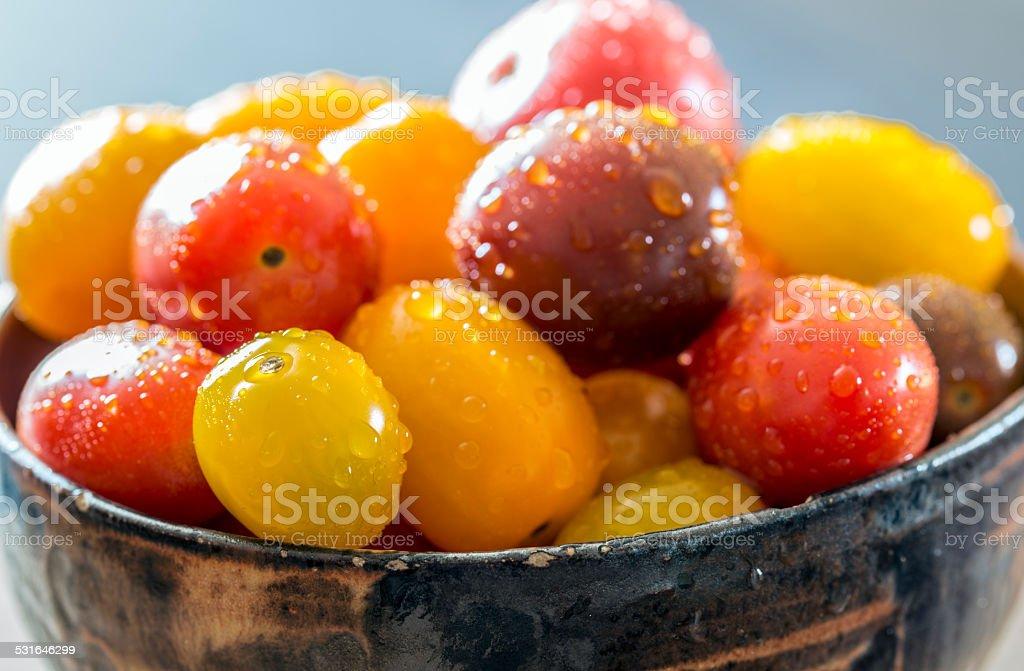 Cherry tomatos in bowl stock photo