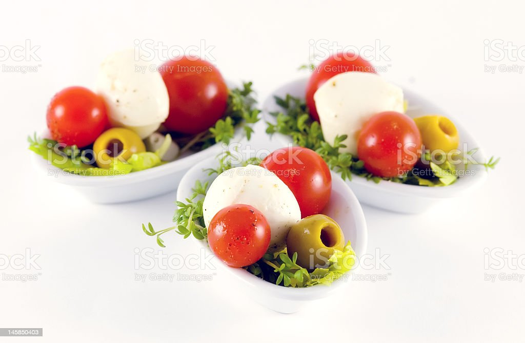Cherry tomatos, mozzarella and olives - italian style royalty-free stock photo